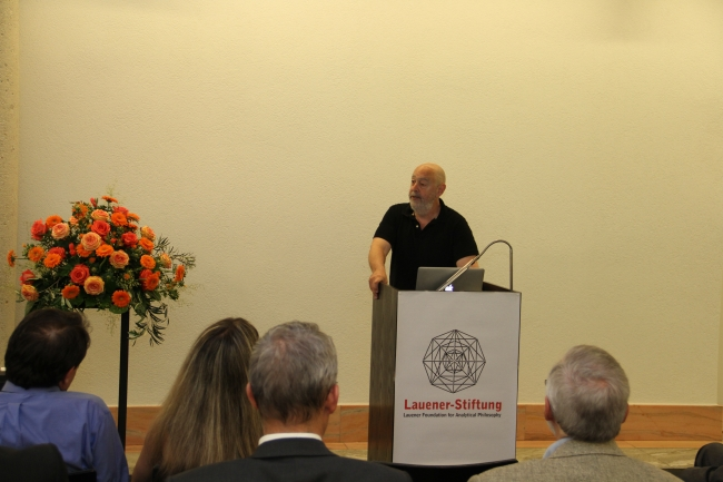 Prof. Dr. Charles Travis, Laudatio for Professor Hilary Putnam